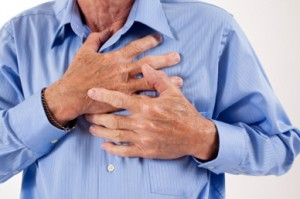 man-with-angina-clenching-chest